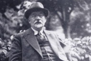 Aron Freimann, seated outdoors.JPG