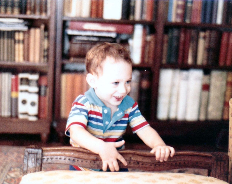Frank Herz collection A picture of our son Jay (now 34) as a baby in front of bookcases holding part of Frank Herz's collection. It reminds David of how.jpg