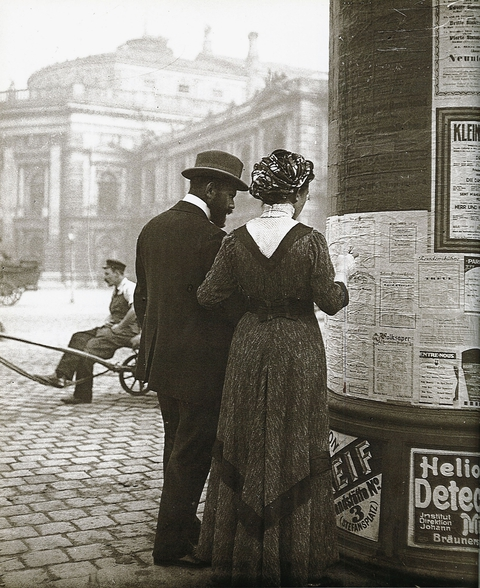 Emil Mayer - Man and Woman at an Advertising Column